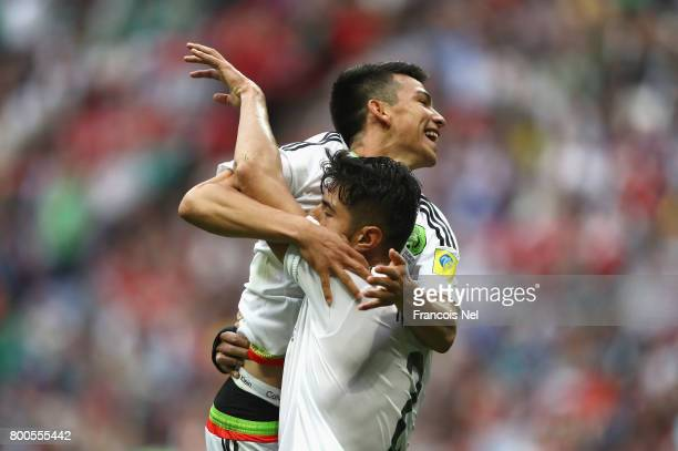Nestor Araujo of Mexico celebrates scoring his sides first goal with his Mexico team mate during the FIFA Confederations Cup Russia 2017 Group A...