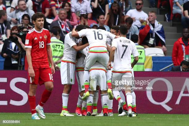 Nestor Araujo of Mexico celebrates with teammates after scoring a goal to make the score 11 during the FIFA Confederations Cup Russia 2017 Group A...