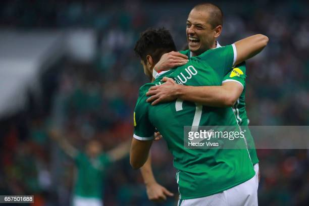Nestor Araujo of Mexico celebrates with teammates after scoring the second goal of his team during the fifth round match between Mexico and Costa...