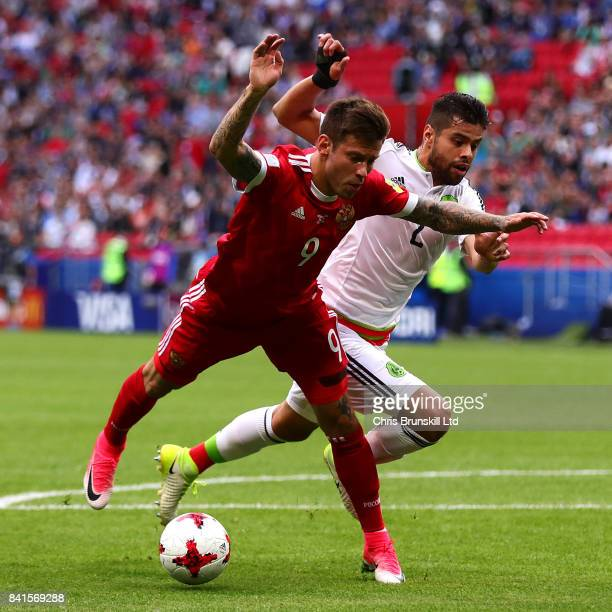 Nestor Araujo of Mexico in action with Fedor Smolov of Russia during the FIFA Confederations Cup Russia 2017 Group A match between Mexico and Russia...