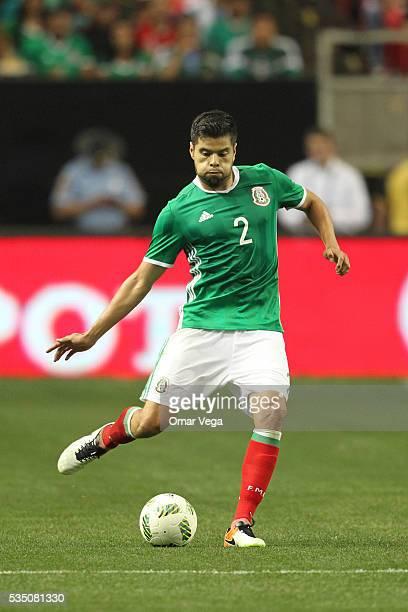 Nestor Araujo of Mexico kicks the ball during the International Friendly between Mexico and Paraguay at Georgia Dome on May 28 2016 in Atlanta Georgia
