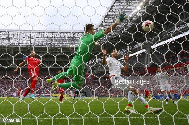 Nestor Araujo of Mexico scores his sides first goal past Igor Akinfeev of Russia during the FIFA Confederations Cup Russia 2017 Group A match between...
