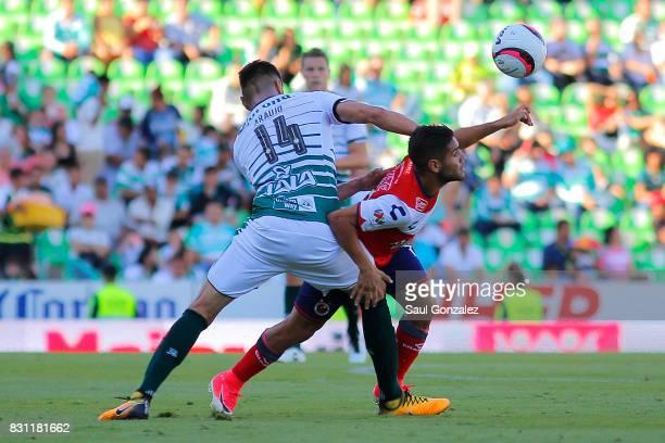 Nestor Araujo of Santos and Daniel Villalva of Veracruz fight for the ball during the 4th round match between Santos Laguna and Veracruz as part of...