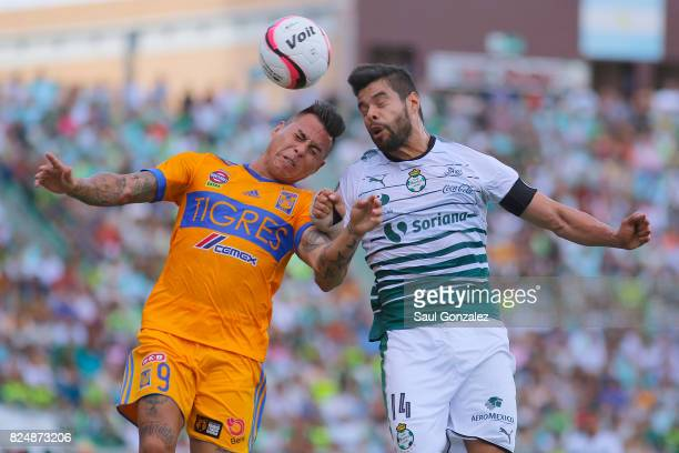 Nestor Araujo of Santos and Eduardo Vargas of Tigres jump for a header during the 2nd round match between Santos Laguna and Tigres UANL as part of...