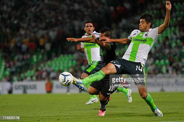 Nestor Araujo of Santos fights for the ball with Brian Doncel of Zacatepec during a match between Santos and Zacatepec as part of Copa MX at Modelo...