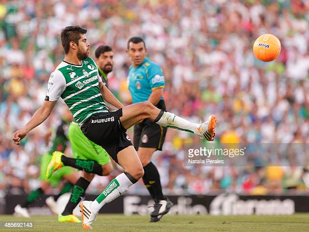 Nestor Araujo of Santos kicks the ball during a match between Santos Laguna and Chiapas as part of round 16th Clausura 2014 Liga MX at Corona Stadium...