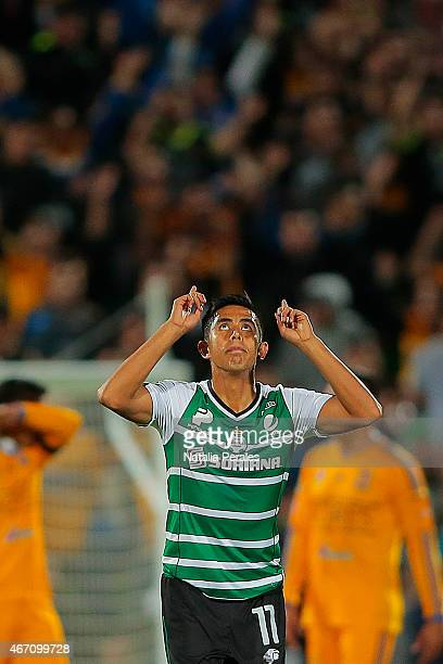 Nestor Calderon celebrates after scoring the first goal of his team during a match between Santos Laguna and Tigres UANL as part of 11th round...