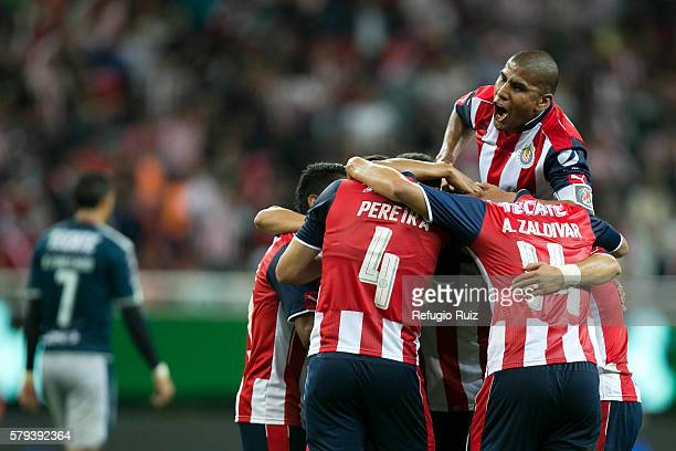 Nestor Calderon of Chivas celebrates with teammates after scoring the first and winning goal during the 2nd round match between Chivas and Monterrey...