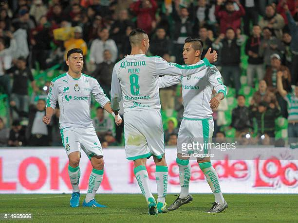 Nestor Calderon of Santos Laguna celebrates with teammates after scoirng his team's first goal during the 10th round match between Santos Laguna and...