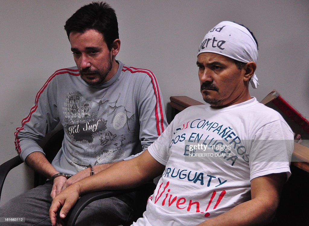 Nestor Castro (L) and Ruben Villalba, who presently are on hunger strike, two of the 14 farmers tried for the June 15, 2012 slaughter of Curuguaty, where 11 farmers and 6 policemen were killed, appear in court in Coronel Oviedo, Paraguay, on February 14, 2013. The hearing was postponed after the defence of the accused challenged judge Jose Benitez. AFP PHOTO NORBERTO DUARTE