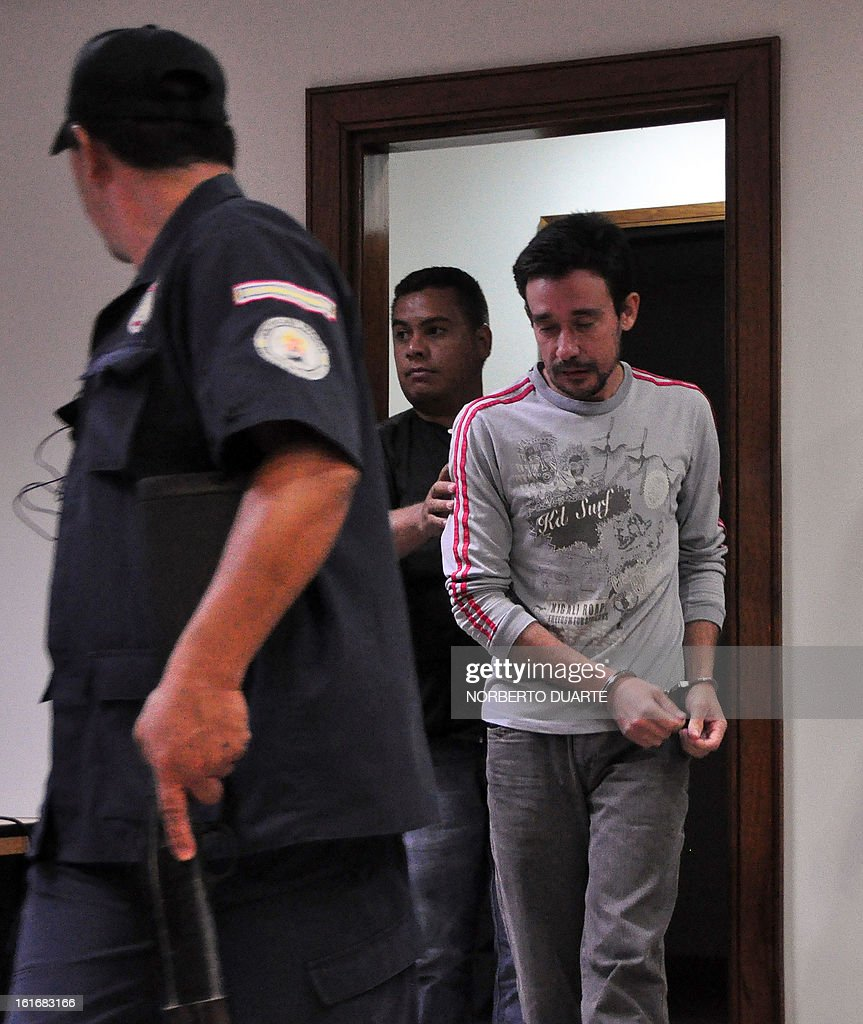 Nestor Castro (R), one of the 14 farmers tried for the June 15, 2012 slaughter of Curuguaty, where 11 farmers and 6 policemen were killed, arrives in court in Coronel Oviedo, Paraguay, on February 14, 2013. The hearing was postponed after the defence of the accused challenged judge Jose Benitez.