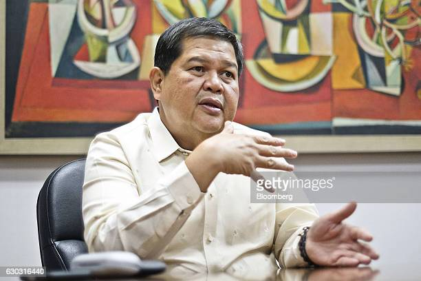 Nestor Espenilla deputy governor of the Bangko Sentral ng Pilipinas gestures as he speaks during an interview in Manila the Philippines on Monday Dec...