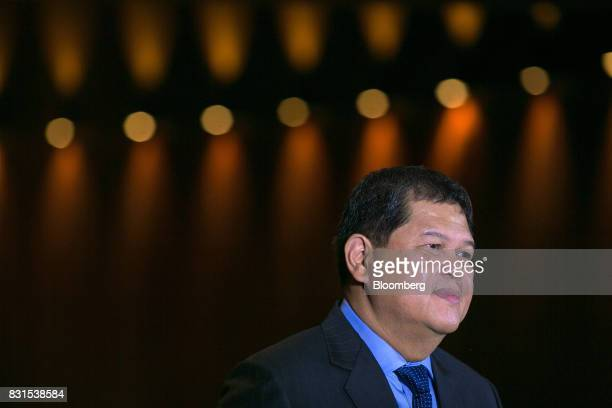 Nestor Espenilla governor of the Bangko Sentral ng Philipinas listens during a Bloomberg Television interview in Singapore on Tuesday Aug 15 2017 The...