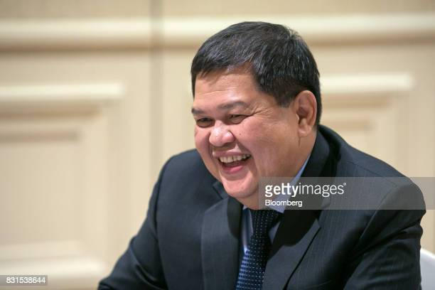 Nestor Espenilla governor of the Bangko Sentral ng Philipinas reacts during an interview in Singapore on Tuesday Aug 15 2017 The central bank is...