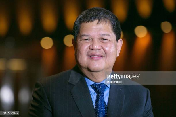 Nestor Espenilla governor of the Bangko Sentral ng Philipinas stands for a photograph following a Bloomberg Television interview in Singapore on...