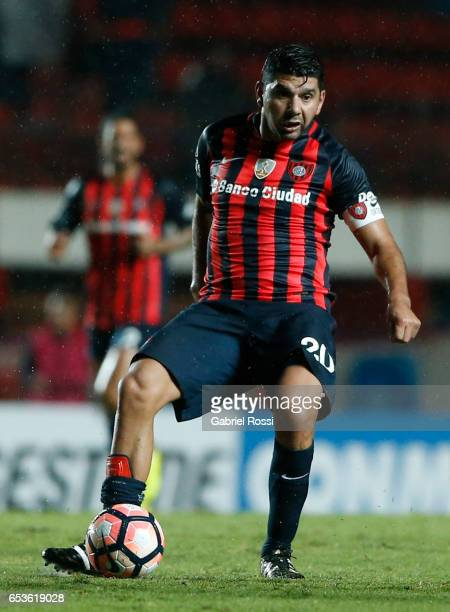 Nestor Ezequiel Ortigoza of San Lorenzo drives the ball during a group stage match between San Lorenzo and Atletico Paranaense as part of Copa...