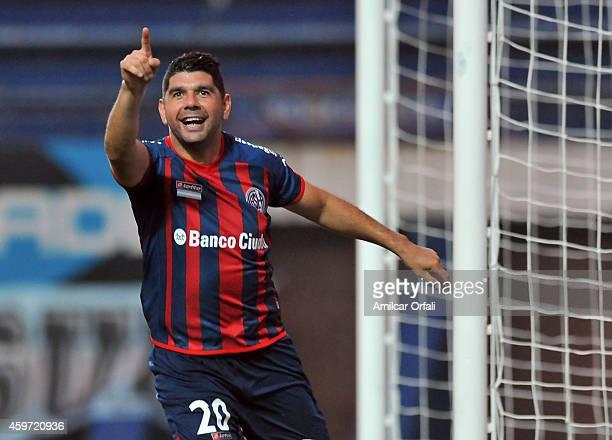 Nestor Ortigoza of San Lorenzo celebrates after scoring the opening goal from a penalty kick during a match between San Lorenzo and Estudiantes as...