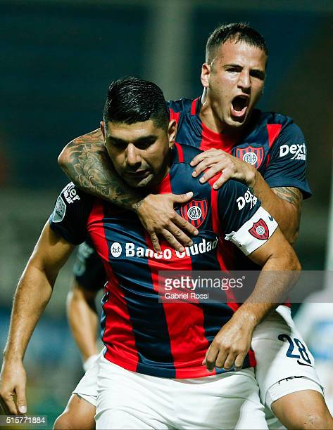 Nestor Ortigoza of San Lorenzo celebrates with Franco Mussis after scoring the opening goal during a match between San Lorenzo and Gremio as part of...
