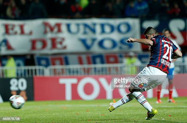 Nestor Ortigoza of San Lorenzo takes a penalty kick to score during the second leg final match between San Lorenzo and Nacional as part of Copa...