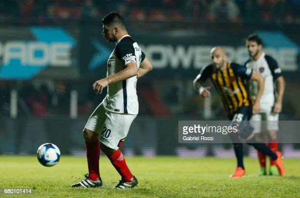 Nestor Ortigoza of San Lorenzo takes a penalty kick to score the first goal of his team during a match between San Lorenzo and Rosario Central as...
