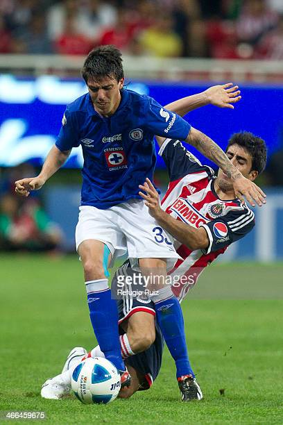 Nestro Vidrio of Chivas fights for the ball with Mauro Formica of Cruz Azul during a match between Chivas and Cruz Azul as part of the Clausura 2014...