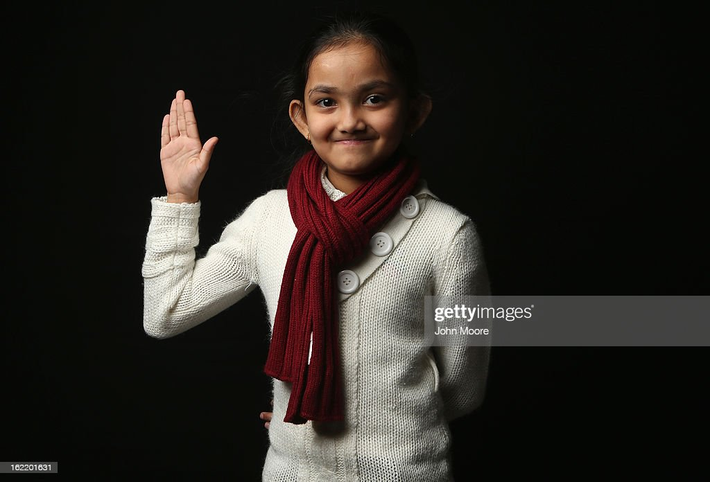 Neswima Akter, 9, who immigrated with her parents from Bangladesh to Brooklyn, awaits her American citizenship certificate at the U.S. Citizenship and Immigration Services (USCIS), office on February 19, 2013 in New York City. Her father, Zamal Uddan, is a construction worker. Almost 300 foreign-born children of naturalized immigrants received citizenship certificates Tuesday at the center during the special event. Children of naturalized immigrants receive U.S. citizenship if they arrive to the United States as minors, but they must go through a process at USCIS to receive official citizenship documents proving they have become Americans.