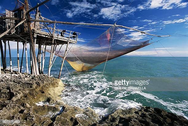 Net fishing from a trebuchet in Molinella Vieste Gargano national park Apulia Italy