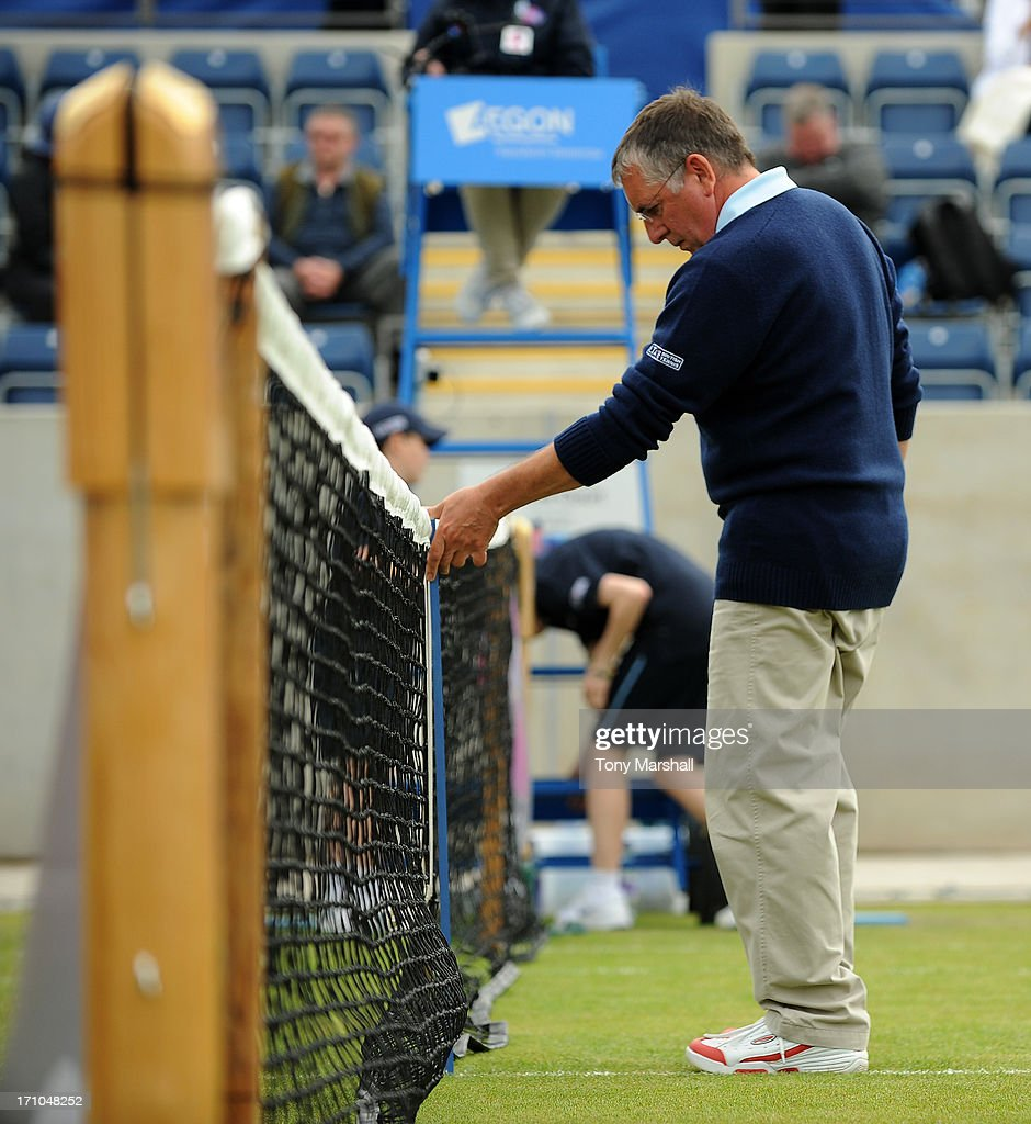 A net judge measures the height of the net during The AEGON Classic Tennis Tournament at Edgbaston Priory Club on June 11, 2013 in Birmingham, England.