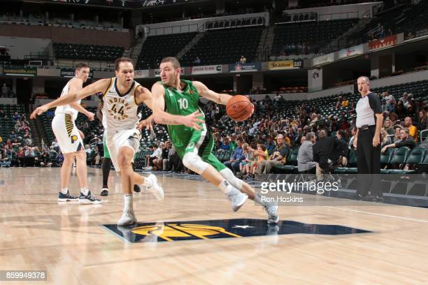 Netanel Artzi of the Maccabi Haifa handles the ball during the preseason game against Bojan Bogdanovic of the Indiana Pacers on October 10 2017 at...