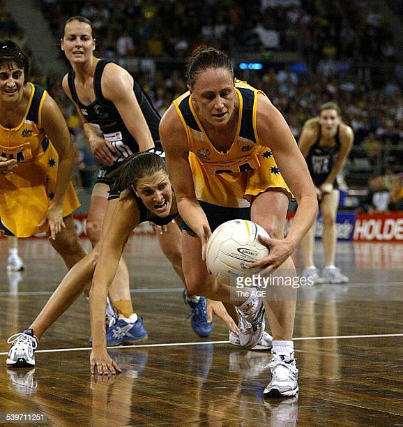 Netball Australia v New Zealand Melbourne 3rd Test Australian Megan Anderson takes the ball in front of Anna Scarlett 20 November 2004 THE AGE SPORT...