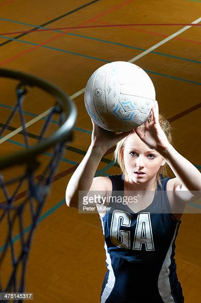 Netball player aiming at goal