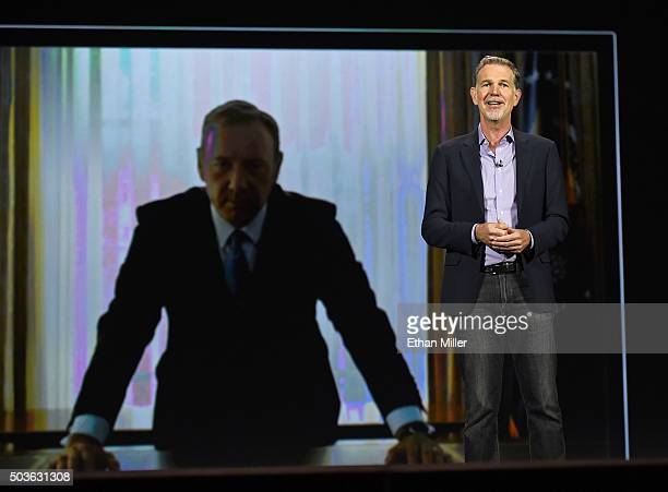 Netflix CEO Reed Hastings delivers a keynote address in front of an image of actor Kevin Spacey from 'House of Cards' at CES 2016 at The Venetian Las...