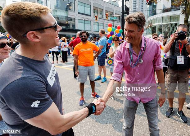 Netflix's Sense8 cast member Brian J Smith and City of Vancouver Mayor Gregor Robertson attend Vancouver Pride Parade on August 6 2017 in Vancouver...