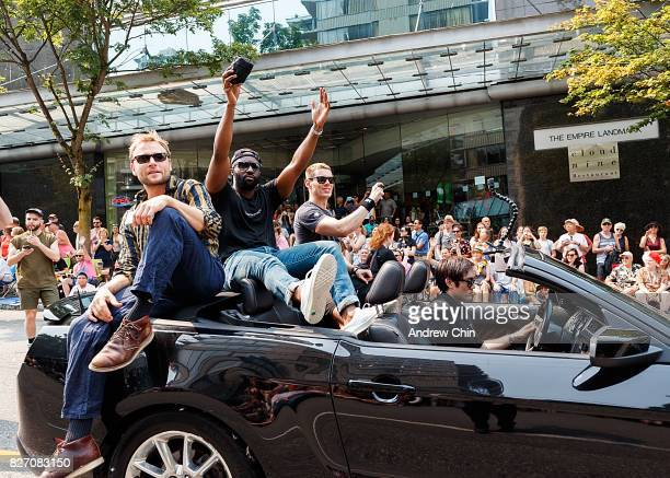 Netflix's Sense8 cast members Max Riemelt Toby Onwumere and Brian J Smith attend Vancouver Pride Parade on August 6 2017 in Vancouver Canada