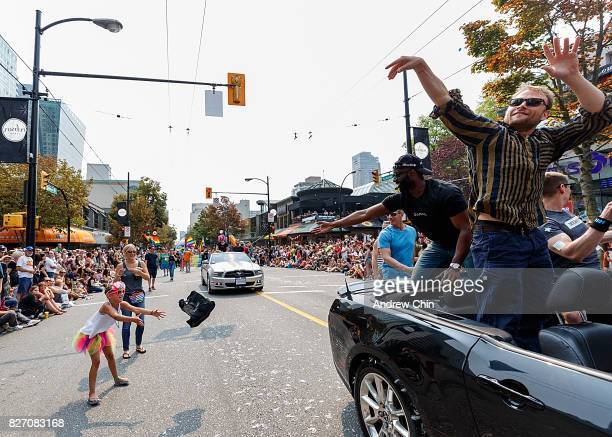 Netflix's Sense8 cast members Toby Onwumere and Max Riemelt attend Vancouver Pride Parade on August 6 2017 in Vancouver Canada