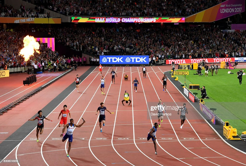 Nethaneel Mitchell-Blake of Great Britain crosses the finishline to win gold ahead of Christian Coleman of the United States as Usain Bolt of Jamaica falls in the Men's 4x100 Relay final during day nine of the 16th IAAF World Athletics Championships London 2017 at The London Stadium on August 12, 2017 in London, United Kingdom.