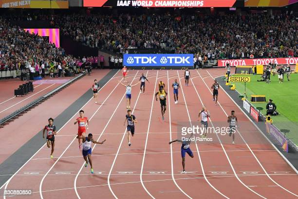 Nethaneel MitchellBlake of Great Britain crosses the finishline to win gold ahead of Christian Coleman of the United States as Usain Bolt of Jamaica...