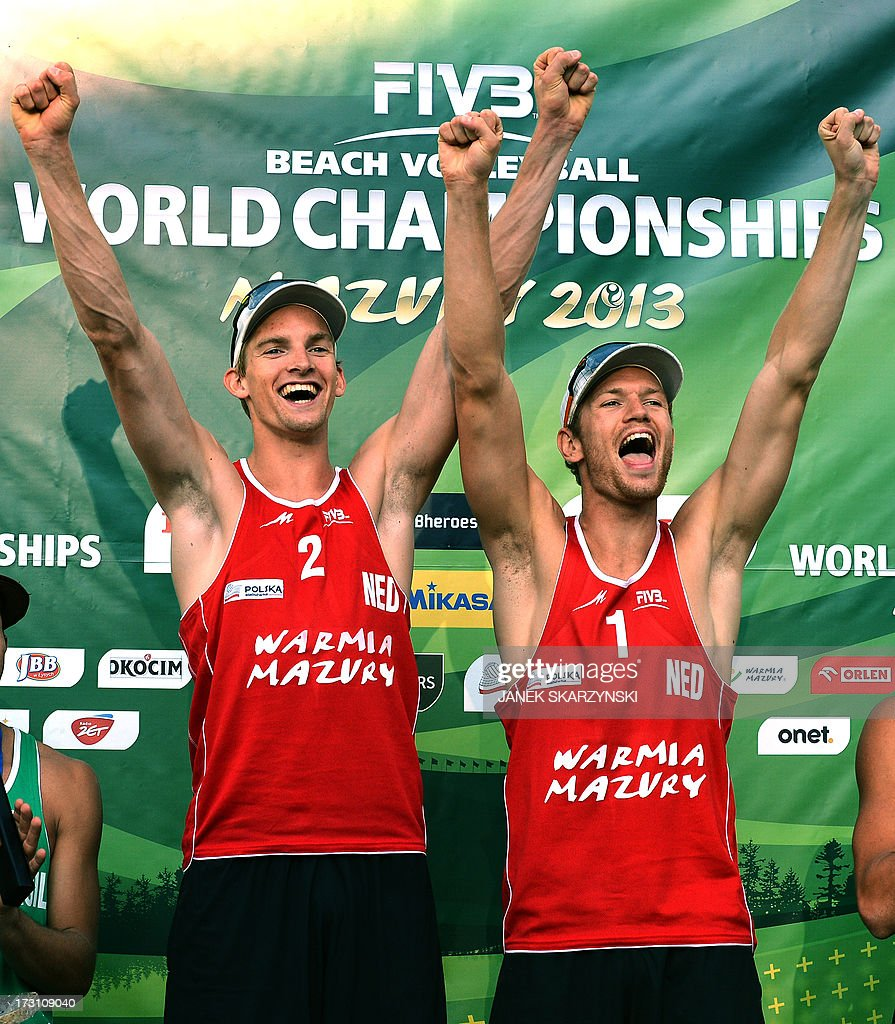 Netherland's Alexander Brouwer (R) and Robert Meeuwsen (L) cheer after they won the gold medal during the final match of the Beach Volleyball World Championships against Brazil on July 7, 2013 in Stare Jablonki, Poland.