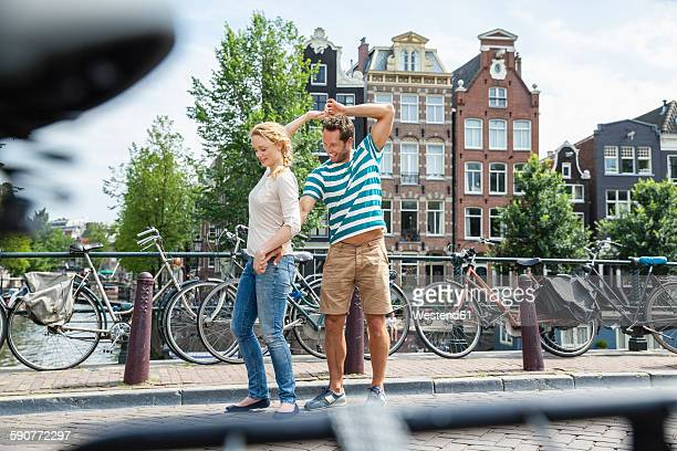 Netherlands, Amsterdam, happy couple in the city