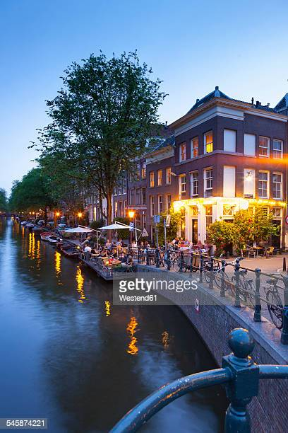 Netherlands, Amsterdam, Restaurant at canal in the evening