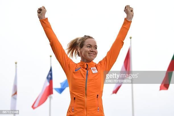 Netherlands' Anna Van Der Breggen poses on the podium after winning the Women's road cycling race at the Rio 2016 Olympic Games in Rio de Janeiro on...