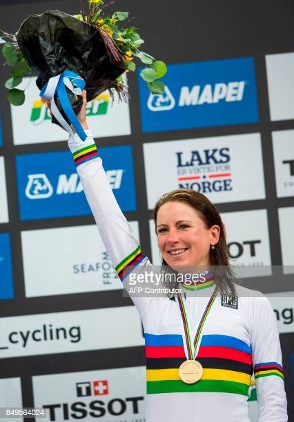 Netherland's Annemiek Van Vleuten celebrates with her gold medal after winning the women elite individual time trial at the UCI Cycling Road World...