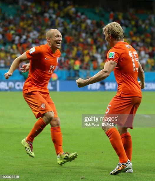 Netherland's Arjen Robben and Dirk Kuyt celebrate after the final whistle