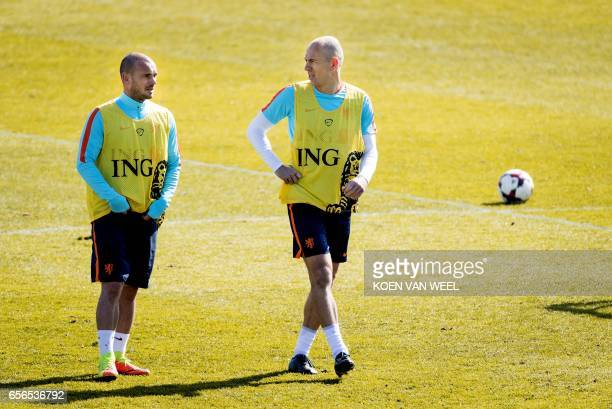 Netherlands' Arjen Robben and Wesley Sneijder take part in a training session of the Dutch national football team on March 22 2017 in Katwijk The...
