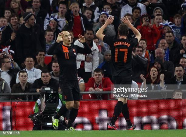 Netherlands' Arjen Robben celebrates with teammate KlaasJan Huntelaar after scoring his side's first goal of the game