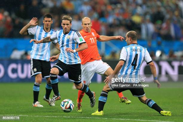 Netherlands' Arjen Robben is crowded out by a combination of Argentina's Lucas Biglia and Pablo Zabaleta during the FIFA World Cup Semi Final at the...
