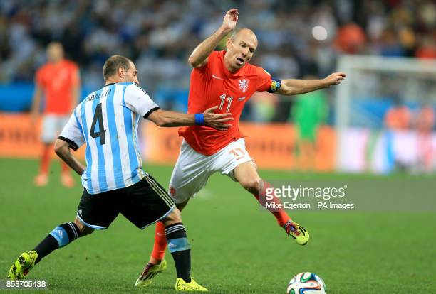 Netherland's Arjen Robben is tackled by Argentina's Pablo Zabaleta