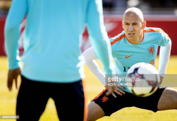 Netherlands' Arjen Robben stretches during a training session of the Dutch national football team on March 22 2017 in Katwijk The Netherlands will...