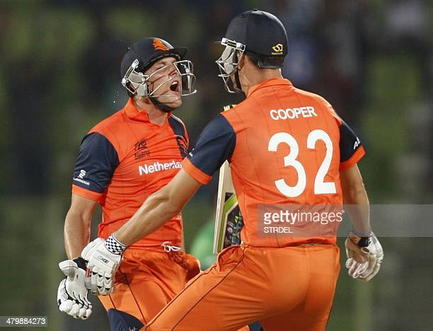 Netherlands' Been Cooper and Wesley Barresi celebrate their team's victory against Ireland during the ICC World Twenty20 tournament Group 2 cricket...