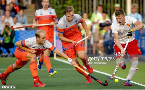 Netherlands Billy Bakker and Floris Wortelboer fights for the ball with England's Sam Ward during the hockey semifinal Netherlands v England at The...